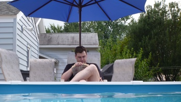 Brian reading poolside